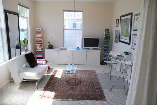 Design Ideas For A Small Modern Living Room In Columbus With Carpet And Freestanding Tv