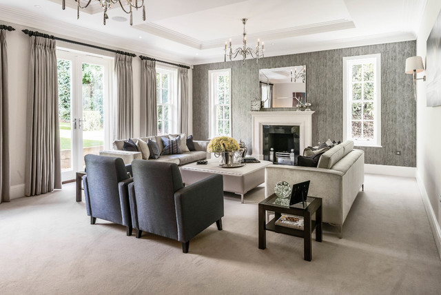 Photo of a traditional formal living room in Surrey with grey walls, carpet and a standard fireplace.