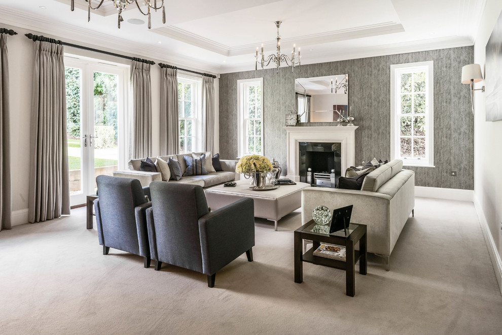 Living room - traditional formal carpeted living room idea in Surrey with gray walls and a standard fireplace