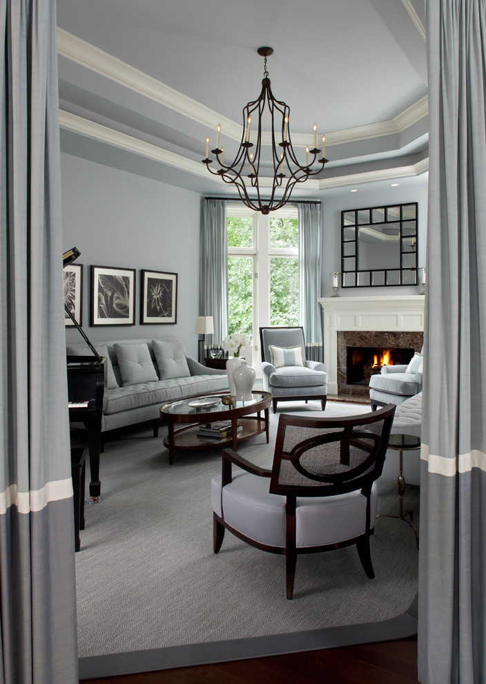 Trendy living room photo in Detroit with a music area, a standard fireplace and gray walls