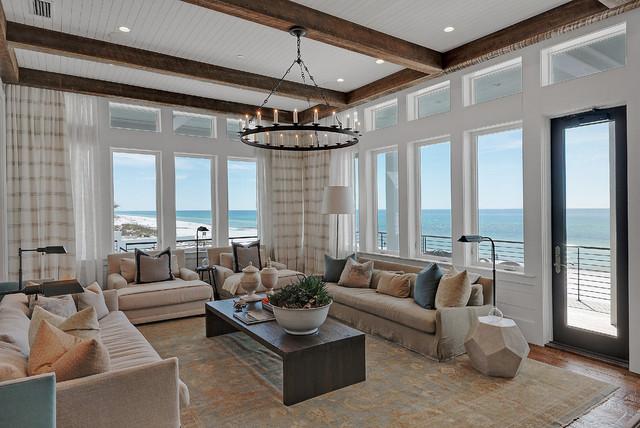 Immagine di un ampio soggiorno stile marino aperto con sala formale, pareti bianche, parquet scuro e nessun camino