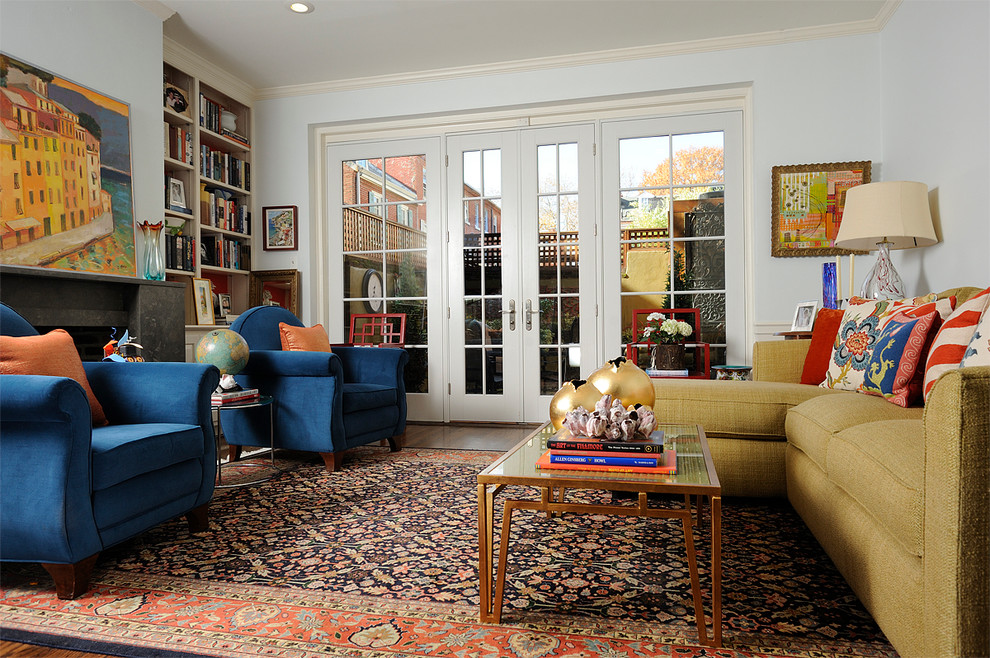Eclectic living room library photo in Philadelphia with blue walls, a standard fireplace and no tv