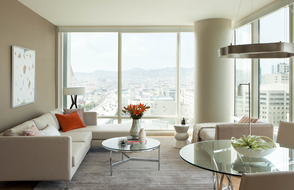 Example of a small trendy formal and open concept light wood floor living room design in San Francisco with gray walls
