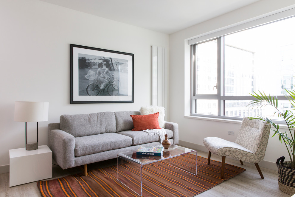 Example of a mid-sized danish open concept and formal light wood floor living room design in San Francisco with white walls