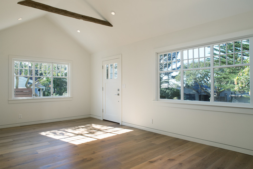 Inspiration for a modern open concept medium tone wood floor living room remodel in San Francisco with white walls, a standard fireplace and a stone fireplace