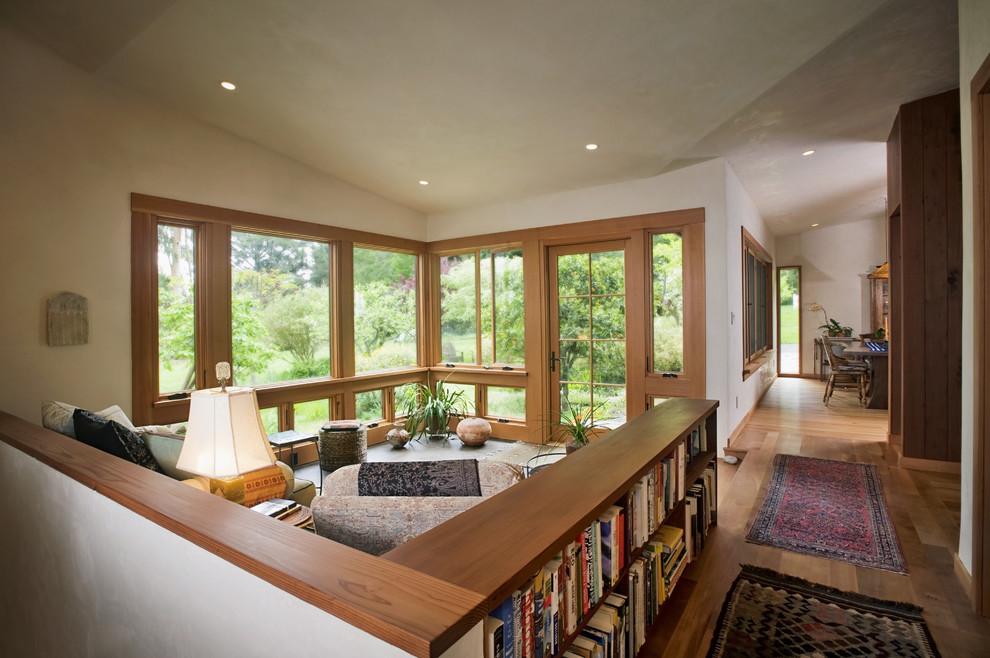 Example of a minimalist open concept medium tone wood floor living room design in San Francisco