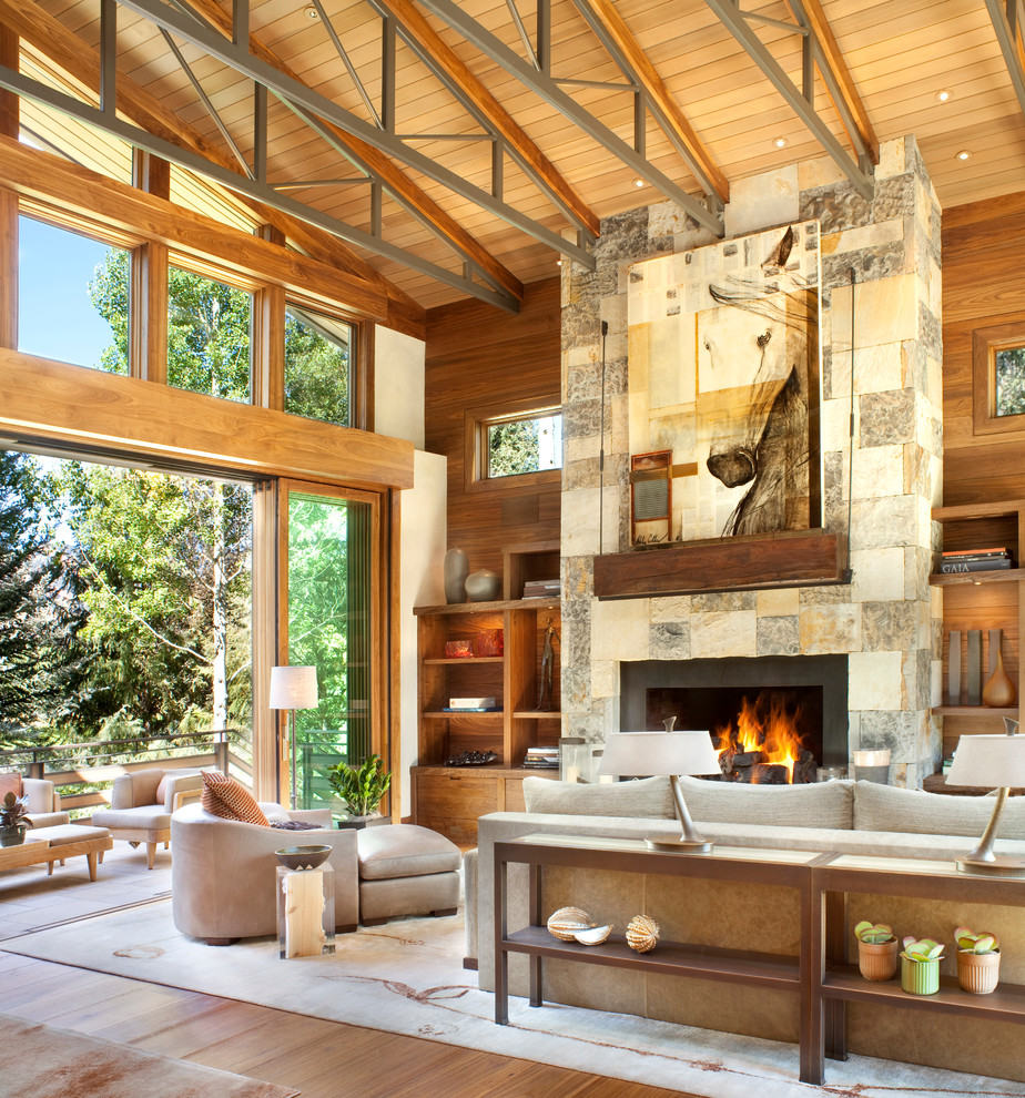 Large mountain style living room photo in Denver with a standard fireplace and a stone fireplace