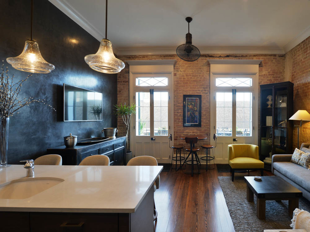 Living room - small eclectic open concept dark wood floor living room idea in New Orleans with a wall-mounted tv, black walls and no fireplace