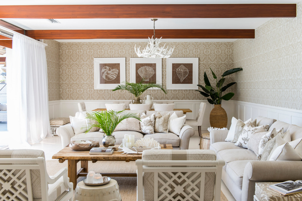 Beach style open concept living room photo in Brisbane with beige walls