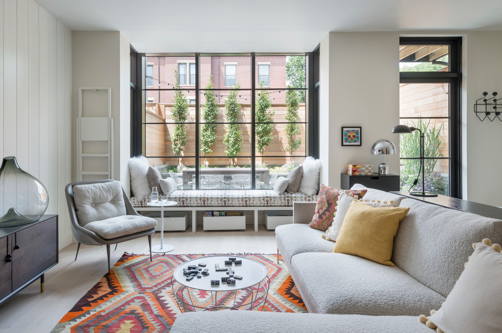 1960s formal and open concept light wood floor living room photo in Boston with white walls and no tv