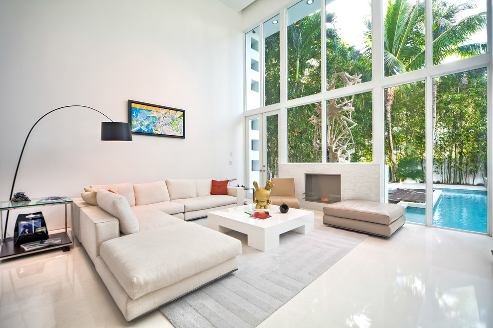 Living room - contemporary formal beige floor living room idea in Miami with white walls and a standard fireplace