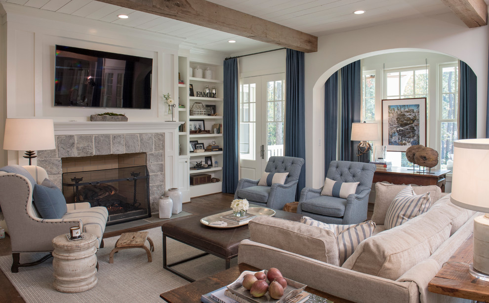 Inspiration for a timeless dark wood floor and brown floor living room remodel in Atlanta with white walls, a standard fireplace, a stone fireplace and a wall-mounted tv