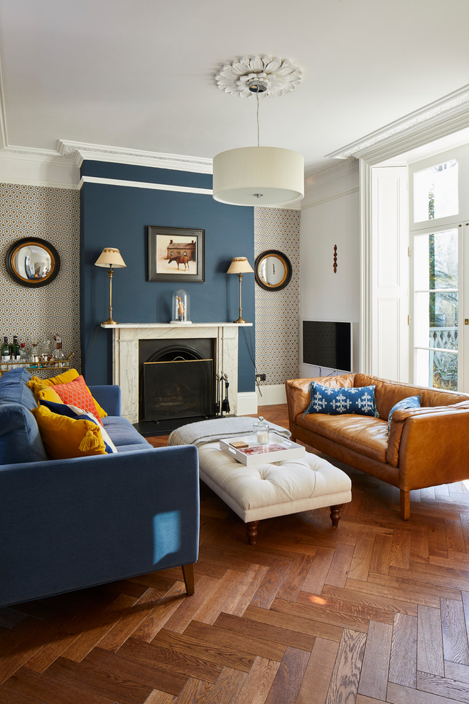 Inspiration for a victorian formal medium tone wood floor and brown floor living room remodel in London with multicolored walls and a standard fireplace