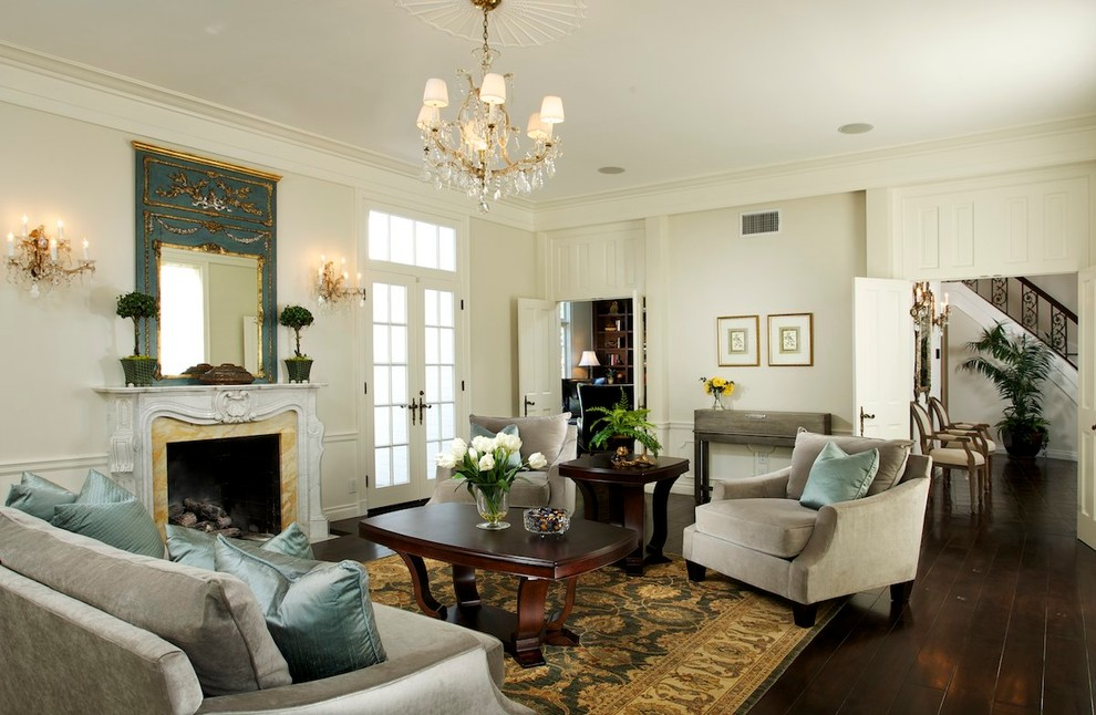 Example of a classic dark wood floor living room design in Los Angeles with a standard fireplace and no tv