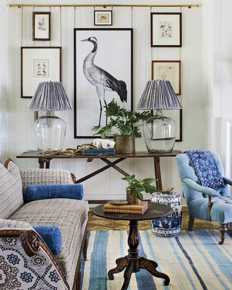 Inspiration for a coastal living room remodel in Jacksonville with white walls