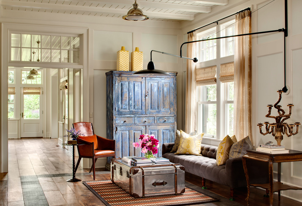 Living room - country formal medium tone wood floor living room idea in Milwaukee with beige walls