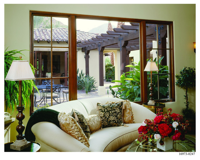 Spanish colonial home style mediterranean living room for Colonial window designs