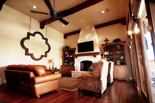 Living room - mid-sized traditional formal and open concept living room idea in Dallas with yellow walls, a standard fireplace, a stone fireplace and a wall-mounted tv