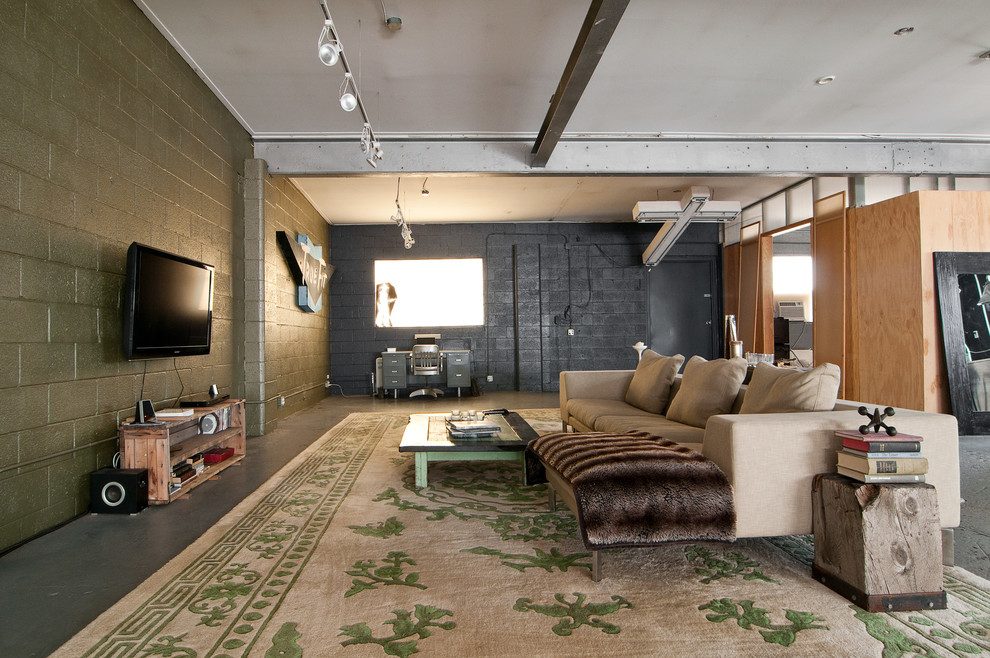 Urban open concept living room photo in Salt Lake City with a wall-mounted tv