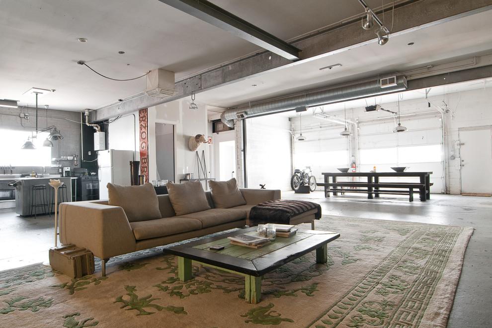 Living room - industrial concrete floor living room idea in Salt Lake City