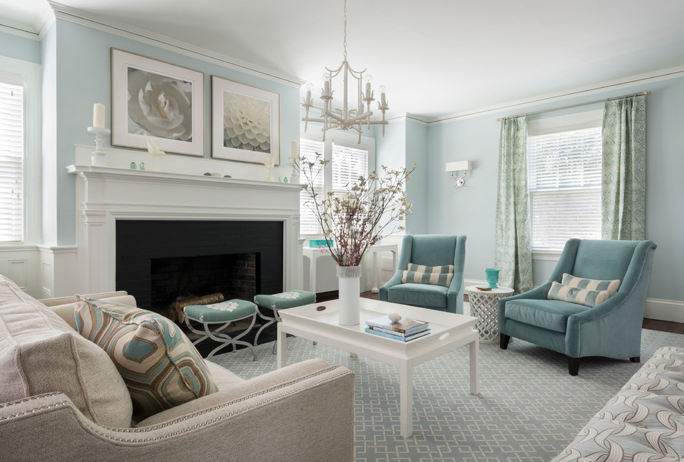 Example of a classic formal living room design in Providence with blue walls and a standard fireplace