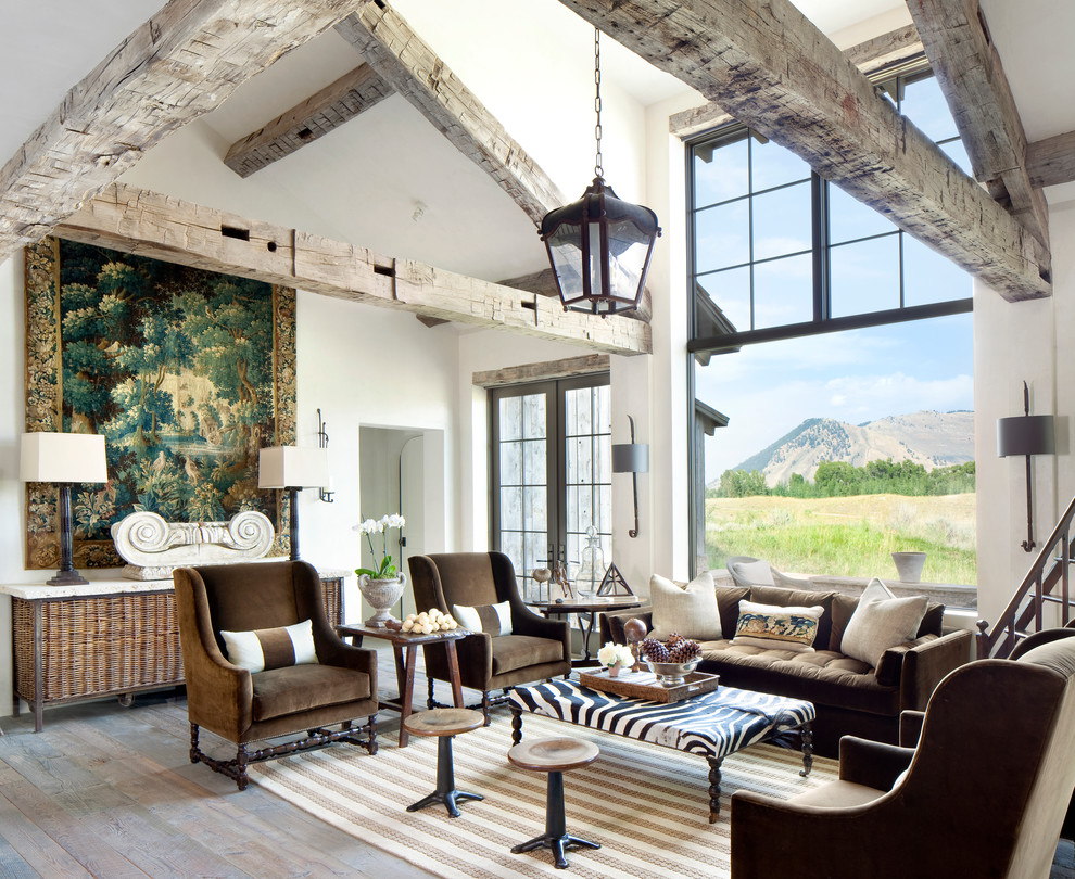 Example of a mountain style open concept and formal medium tone wood floor living room design in Other with no tv, white walls and no fireplace
