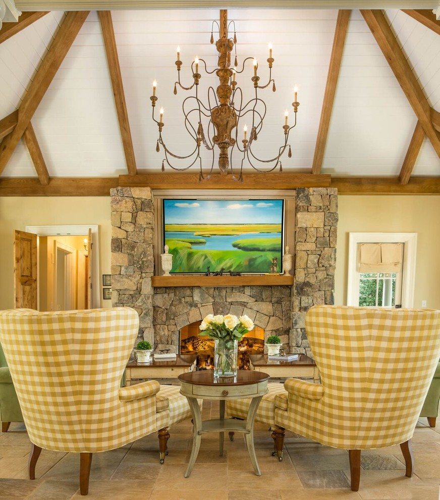 Example of a farmhouse living room design in Raleigh with yellow walls, a standard fireplace and a stone fireplace