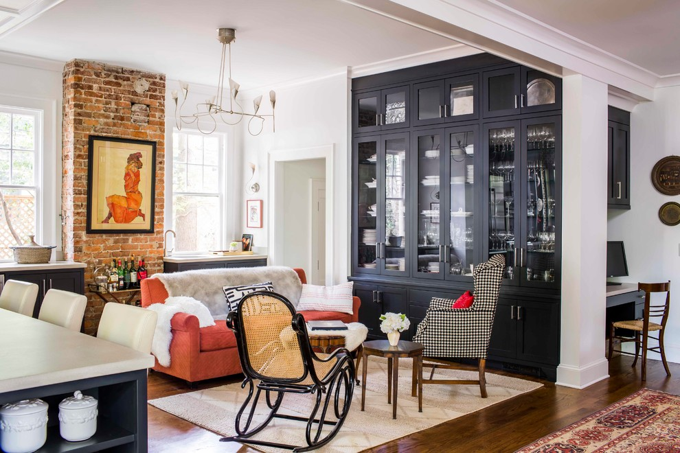 Inspiration for a transitional open concept dark wood floor living room remodel in Atlanta with white walls and no fireplace