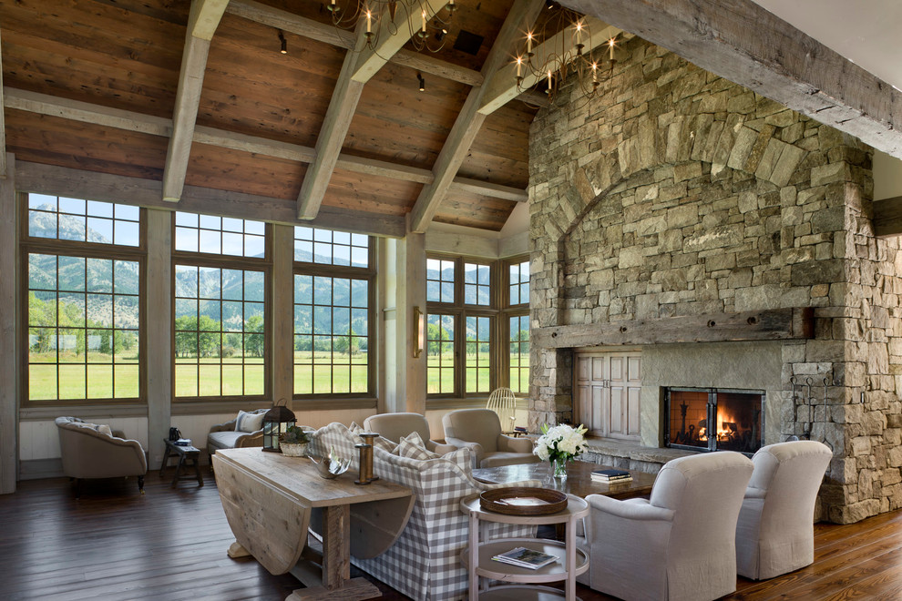 Example of a country living room design in Other with a standard fireplace and a stone fireplace