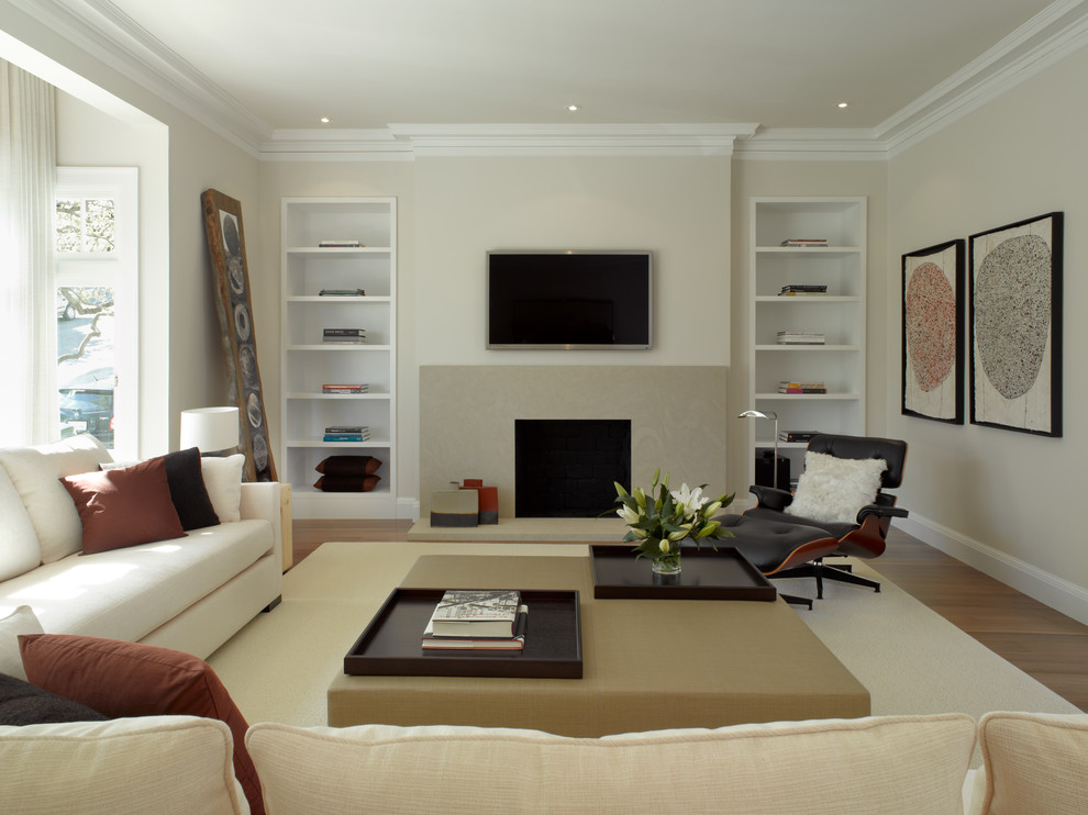 Trendy living room photo in San Francisco with a standard fireplace and a wall-mounted tv