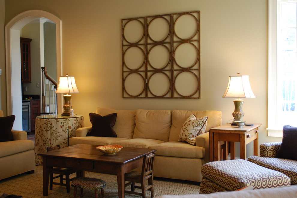 Example of a classic living room design in Other with beige walls