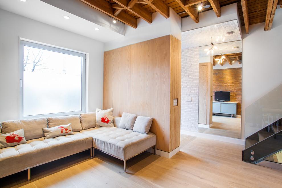 Living room - modern light wood floor living room idea in Toronto with white walls