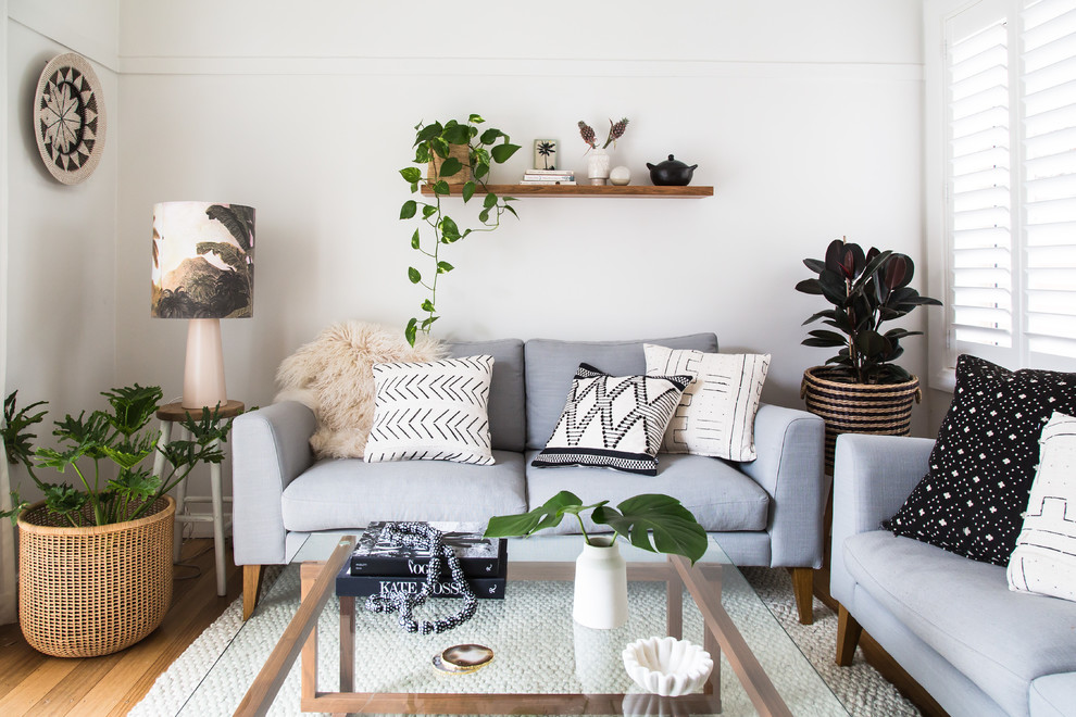 Living room - small coastal enclosed and formal brown floor and medium tone wood floor living room idea in Melbourne with white walls and no fireplace