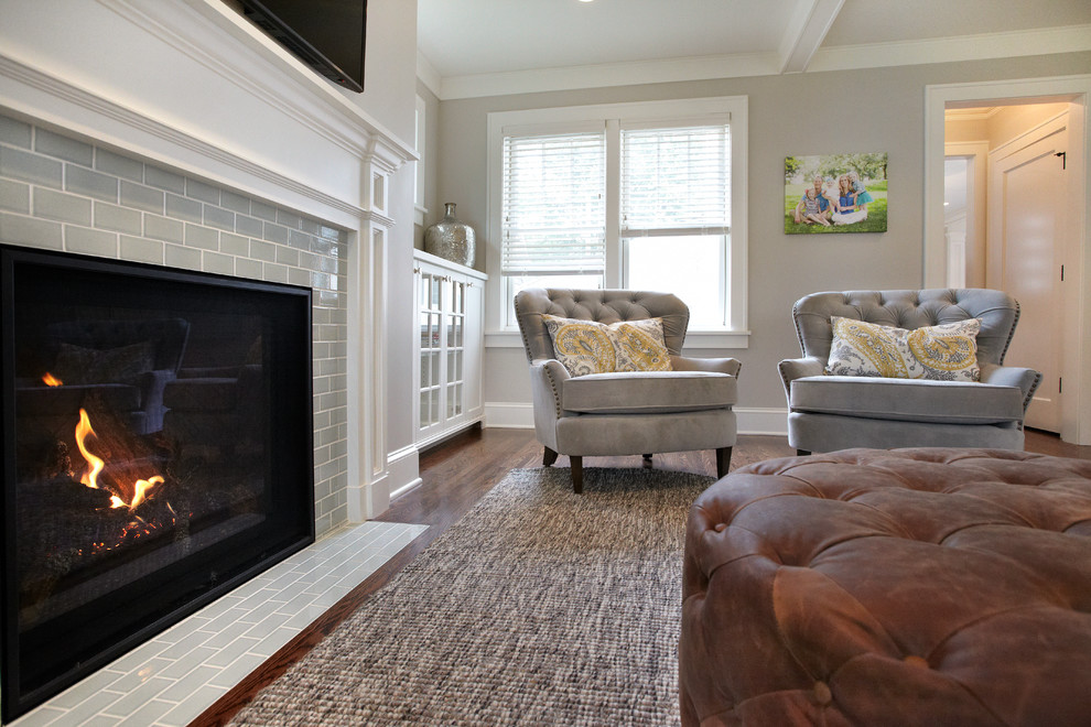 Mid-sized transitional enclosed medium tone wood floor living room photo in Minneapolis with gray walls, a standard fireplace, a tile fireplace and a wall-mounted tv