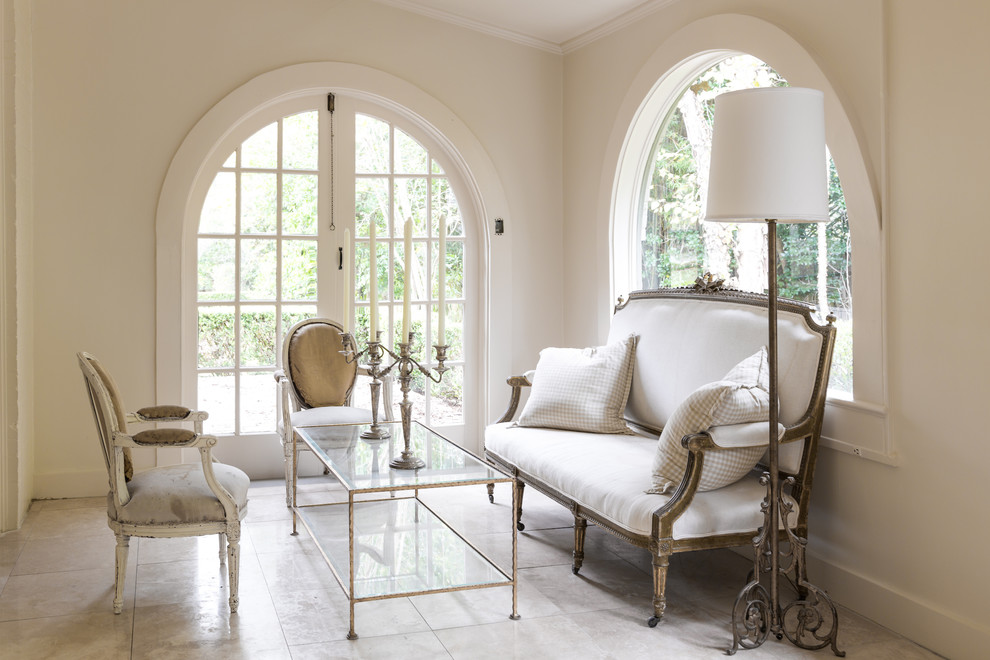 Living room - mid-sized mediterranean formal and enclosed limestone floor and beige floor living room idea in New Orleans with white walls and no fireplace