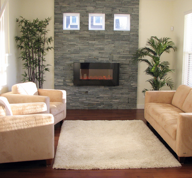 Stacked Stone Fireplace with Natural Light contemporary-living-room