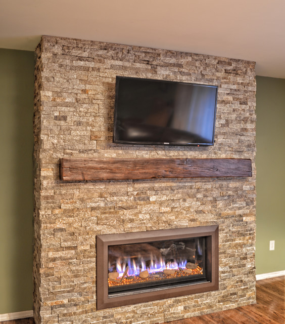 New contemporary linear/ribbon fireplace creating a focal point for the family where once there was a blank wall.  The warm tones of the stone and the