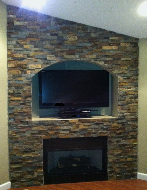 stacked stone wall with arch traditional living room detroit by veneto tile. Black Bedroom Furniture Sets. Home Design Ideas