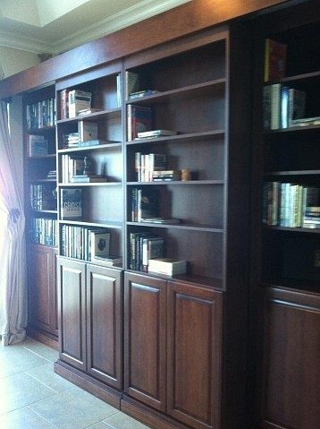 Stained Cherry Sliding Library Murphy Bed Traditional Living Room