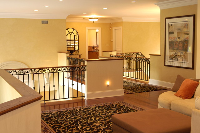 Stairs And Railing And Foyer By Heartwood Corp Traditional - Living room with stairs