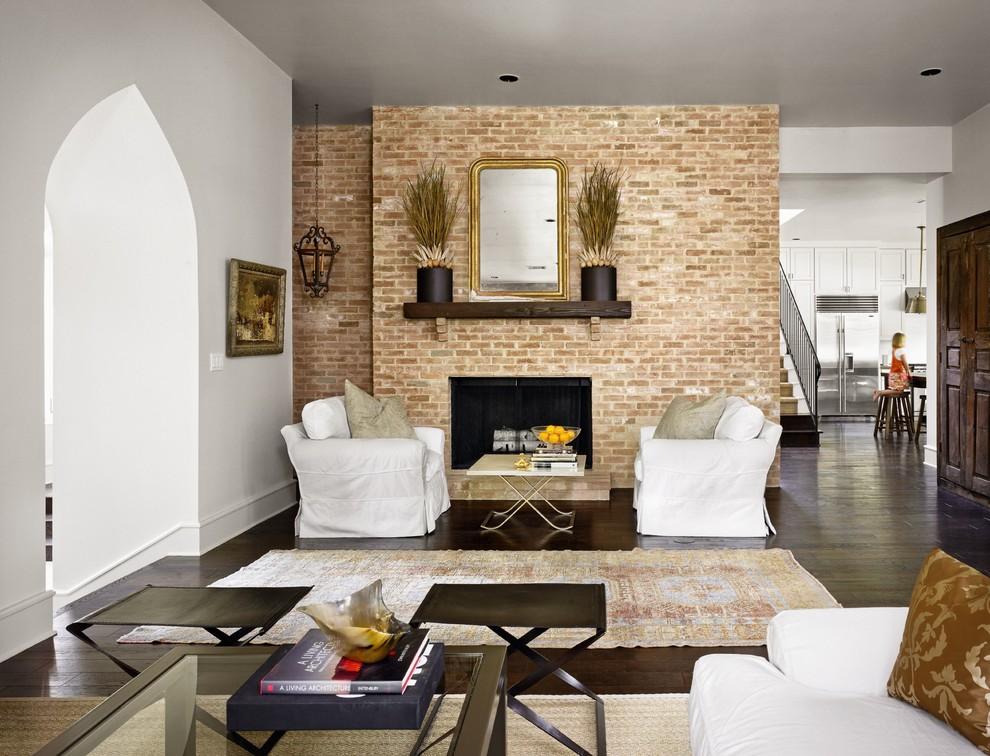 Living room - traditional living room idea in Austin with a brick fireplace