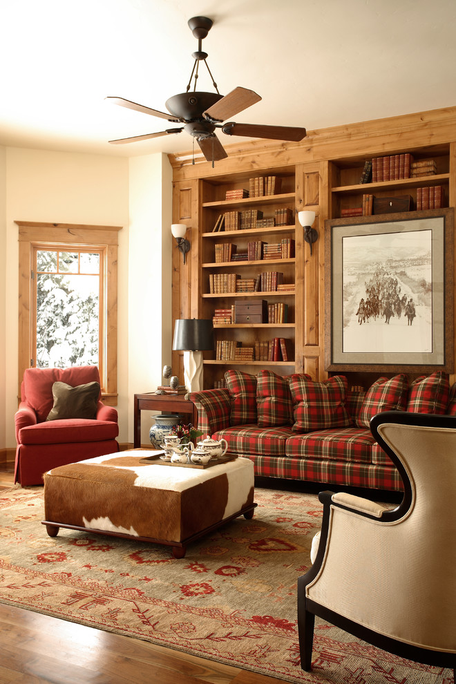 Mountain style medium tone wood floor living room library photo in Denver