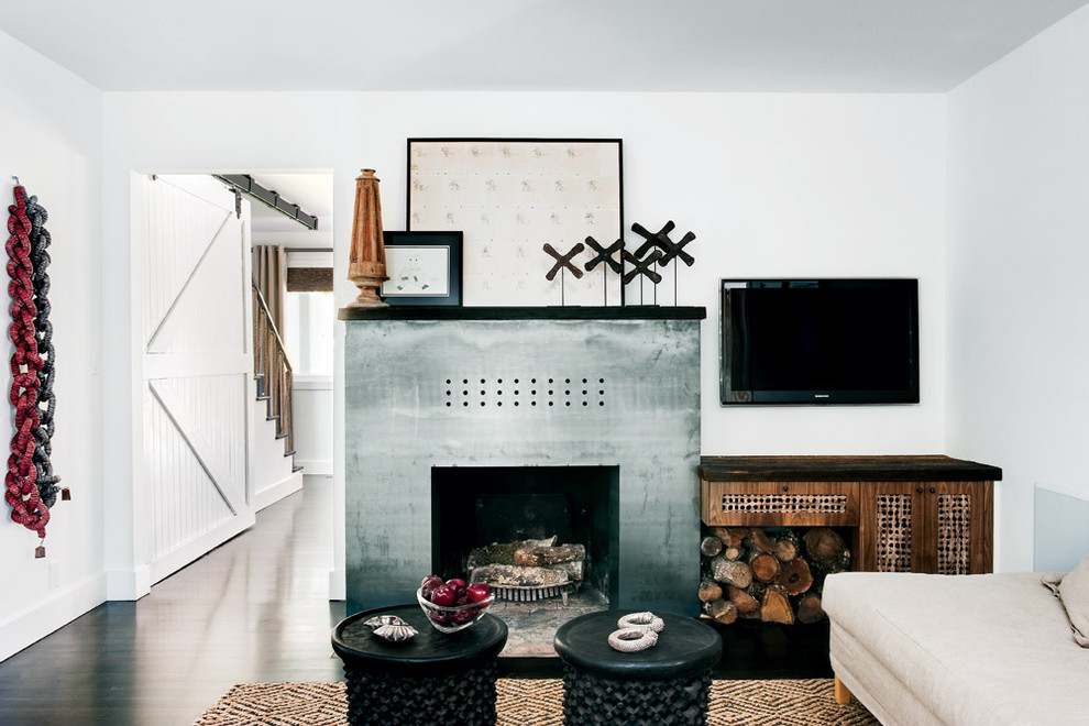 Example of an eclectic living room design in San Francisco with a standard fireplace, a metal fireplace and a wall-mounted tv