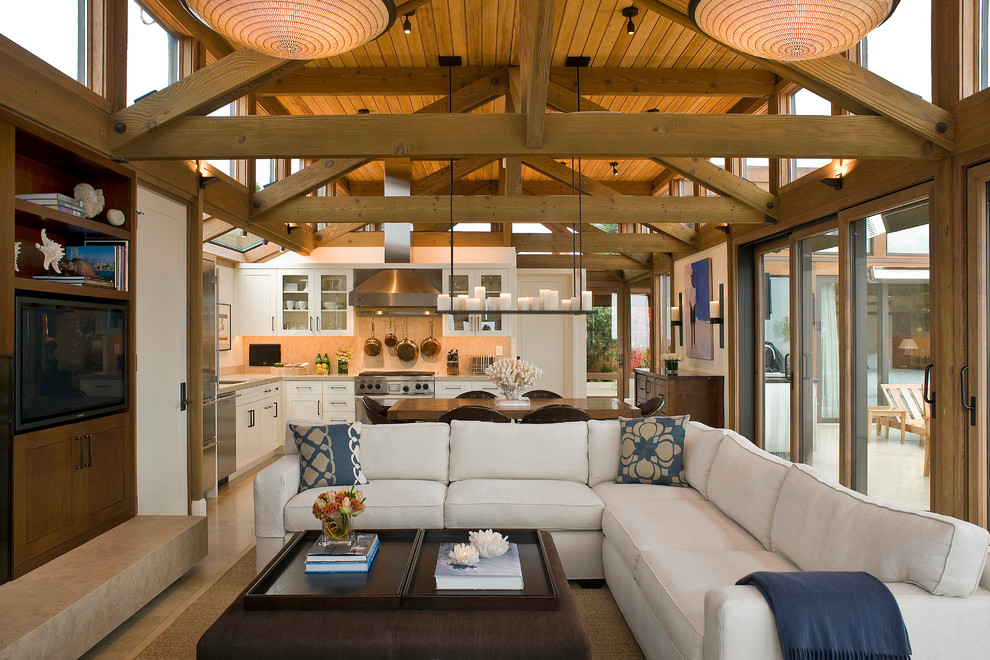 Living room - beach style open concept living room idea in San Francisco with a media wall