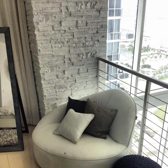 Affordable interior design miami · interior designers decorators stone column in penthouse modern living room
