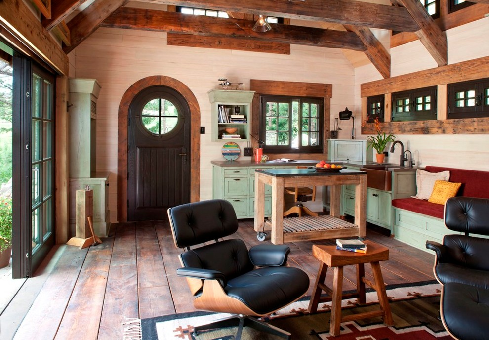 Example of a small mountain style open concept living room design in Denver