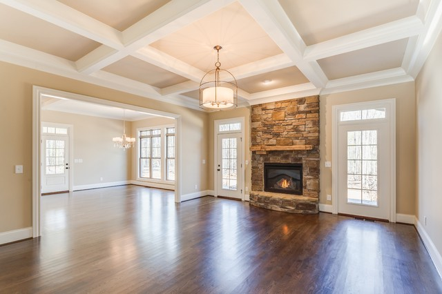 Stone fireplace flanked by french doors traditional for Living room 4 doors