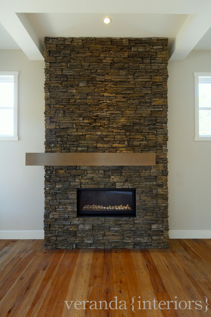 Stone fireplace with off set mantle contemporary living room