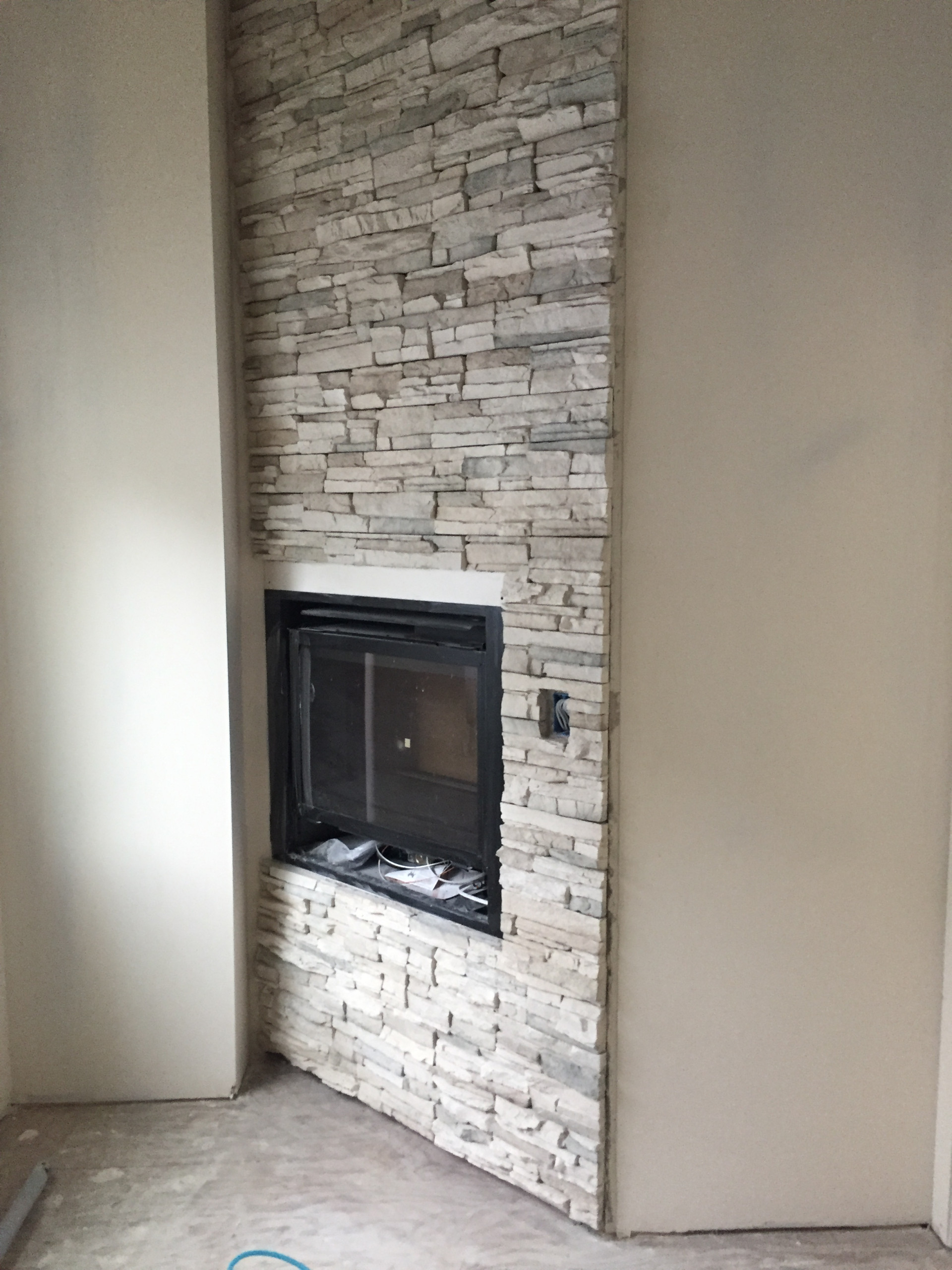 Stone Fireplaces and Wood Mantles