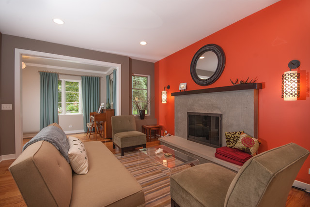 Mid Sized Trendy Living Room Photo In Chicago With Orange Walls And A Standard Fireplace
